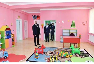 Ильхам Алиев принял участие в церемонии предоставления квартир семьям шехидов и инвалидам войны  - ФОТО