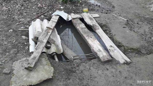 Azərbaycanda dəhşət: Ananın meyiti su quyusunda, körpəninki evdə tapıldı - FOTO